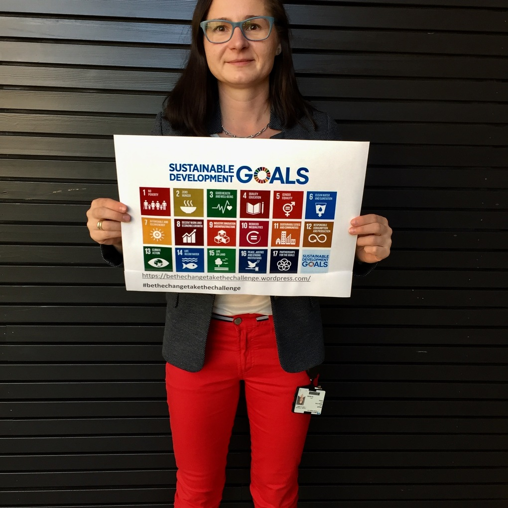 Squared barbara holding the sdgs poster