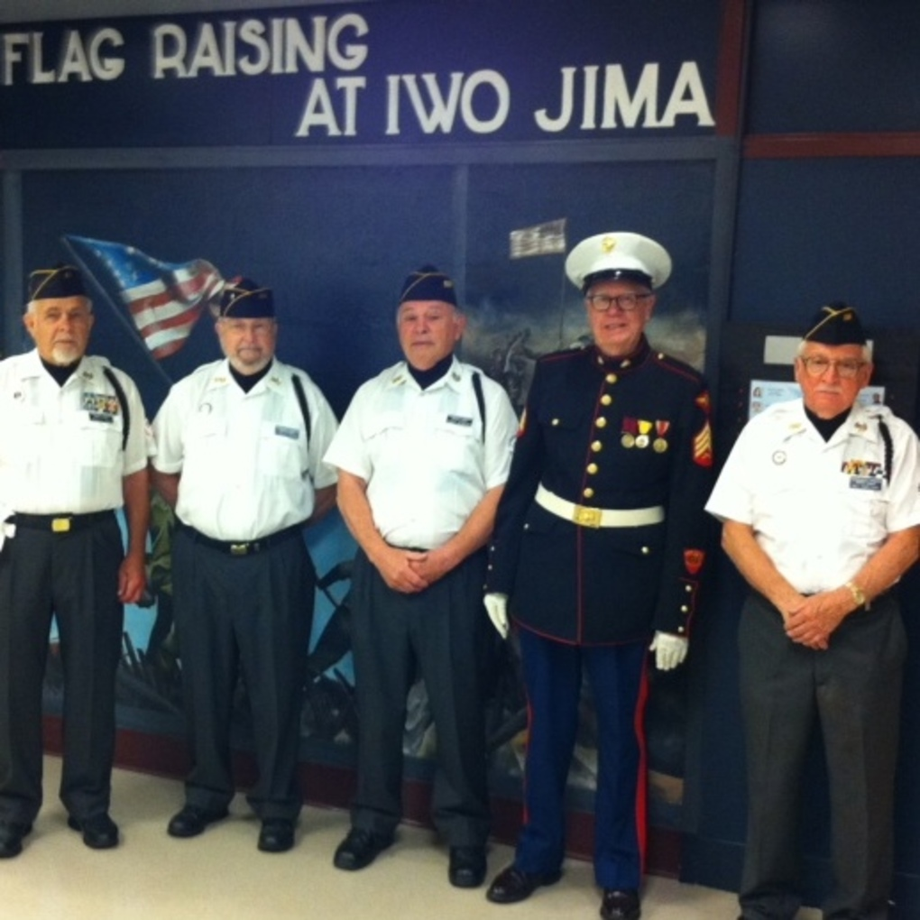 Squared veterans in front of iwo jima